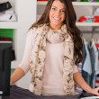 Happy Female Cashier At Counter — Stock Photo #25033379