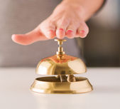 Woman Ringing Service Bell — Stockfoto