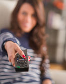 Happy Woman Holding Remote Control — Stok fotoğraf