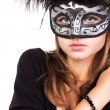 Young woman with masquerade mask — Stock Photo