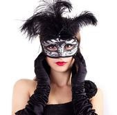 Young woman in carnival mask — Stock Photo