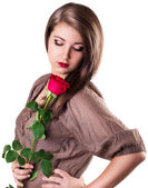 Beautiful girl with red rose — Stock Photo