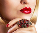 Red lips with ring — Stock Photo