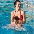 Mother with son in pool — Stock Photo