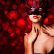 Stock Photo: Beautiful woman in carnival mask