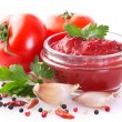 Fresh tomatoes with paste and spice - Stock Photo