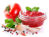Fresh tomatoes with paste — Stock Photo