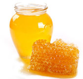 Honing met honingraat — Stockfoto