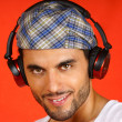 30 years old man with beret and earphones — Stock Photo