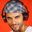 Stock Photo: 30 years old mwith beret and earphones
