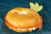 Bagel with soft cheese and smoked salmon — Stock Photo