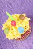 Birthday cupcake with green candle — Stock Photo