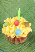 Cupcake with green candle — Stock Photo