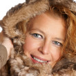 Blond woman with fur hood — Stock Photo
