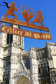 Cathedral and the sign of the old wine shop in Troyes — Stock Photo