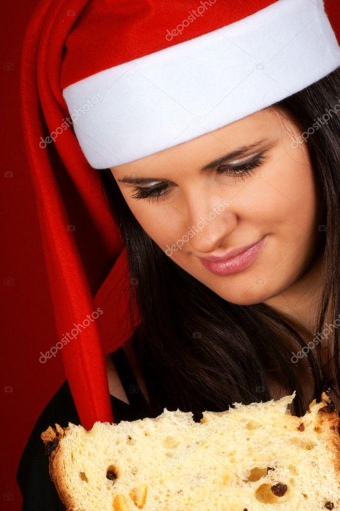 岁美女圣诞老人的女孩吃