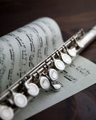Flute and music score — Stock Photo