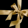 Golden silk ribbon — Stock Photo