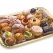 Stock Photo: Pastries on golden tray