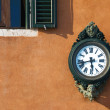 Antigue street clock, Venice - Stock Photo