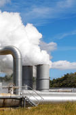 Geothermal power plant pipes and mist — Stock Photo