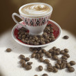 Stock Photo: Coffee beans and cup of coffee