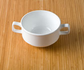 White cup of soup — Stock Photo