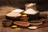 Rice in a wooden bowl — Stock Photo