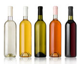 Set of white, rose, and red wine bottles. — Stock Photo