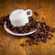 Stock Photo: Cup of coffee with coffee beans