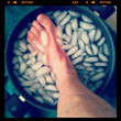 Foot in iced water — Stock Photo #34336489