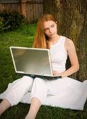 Teen Girl on Laptop Outdoors — Stock Photo