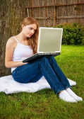 Teen Girl on Laptop Outdoors — Stock Photo