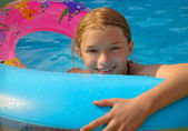 Pre Teen Girl in Backyard Pool — Stock Photo