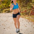 Fitness Female Runner in Park - Stock Photo