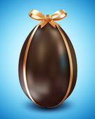 Chocolate Easter Egg with Golden Ribbon and Bow on blue background — Stock Photo