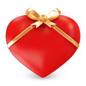 Heart with golden ribbon — Stock Photo
