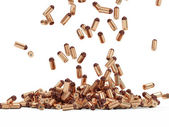 Falling Gun Bullets on white background — Stock Photo