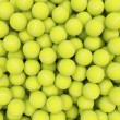 Heap of tennis balls isolated on white background — Stock Photo