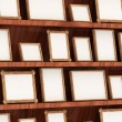 Close-up of Empty Photo Frames on Wooden Shelf — Stock Photo