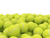 Heap of tennis balls with place for Your text isolated on white background — Stock Photo
