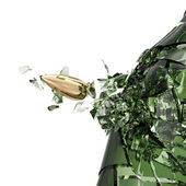Green beer bottle and bullet — Stock Photo