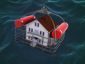 House in basket over water — Stock Photo