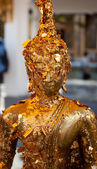 Buddha Image Covered with Gold Leaves — Stock Photo