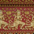 Stock Photo: Thai style gloden deva carving on wood