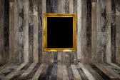 Golden photo frame in old room — Stock Photo