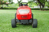 Lawn mower and green grass — Stock Photo