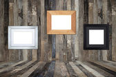 Wooden picture frames on the old wooden wall — Stock Photo