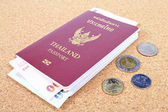 Thailand passport and Thai money — Stock Photo