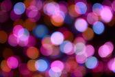 Bokeh colore su uno sfondo scuro — Foto Stock
